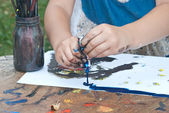 Child hands painting — Stock Photo