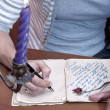 Hand writing a letter — Stockfoto