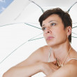Under a beach umbrella — Stock Photo