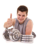 Young man exercising with a dumbbell — Stock Photo