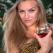 Foto Stock: Blonde woman with a glass