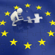 3d man finalizing European Union flag puzzle — Stock Photo