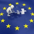 Royalty-Free Stock Photo: 3d man finalizing European Union flag puzzle