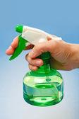 Hand holding water sprayer — Stock Photo