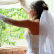 The bride waits at a window of the groom — Stock Photo