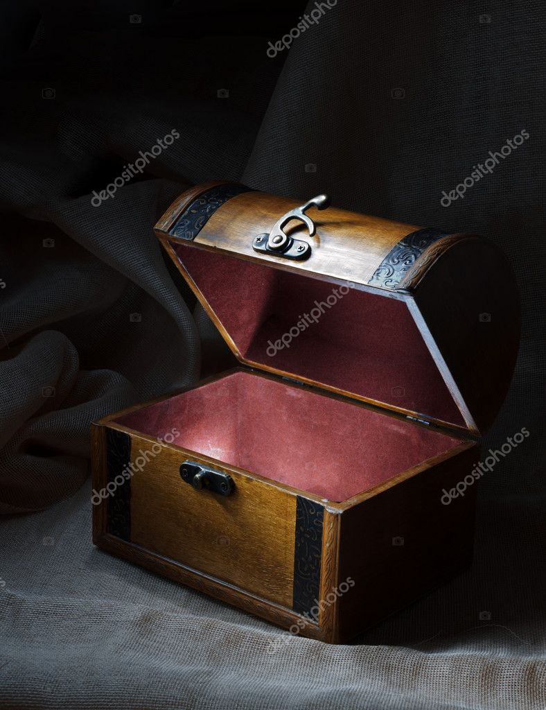 Wooden chest with light from inside.  Stock Photo #5931371