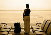 Woman in airport — Stock Photo