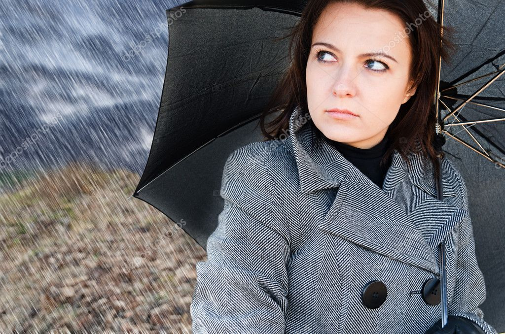 Young woman with black umbrella. — Stock Photo #5970774