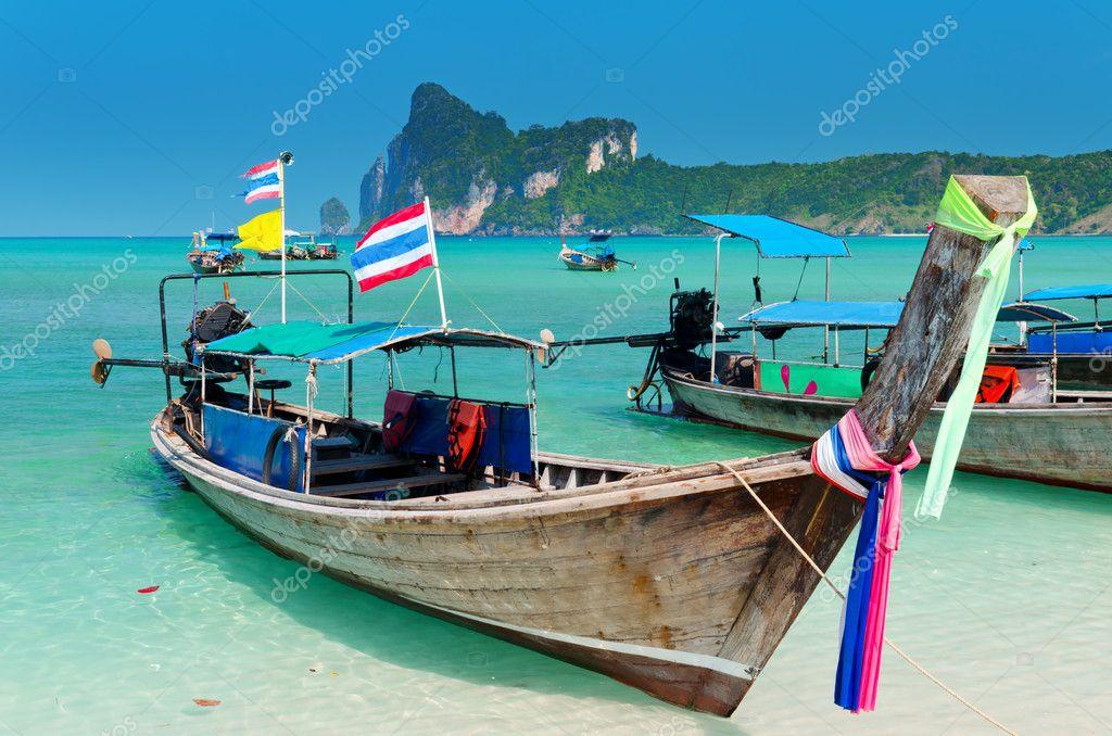 лодки на рейли