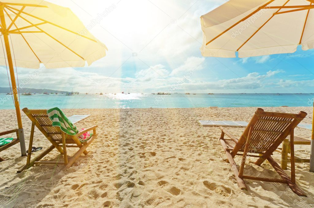 Chairs on white sand beach.  Stock Photo #5986781