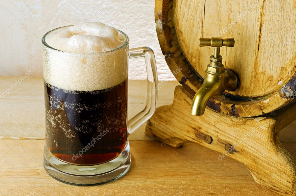 Dark beer on the table.  Stock Photo #6570903