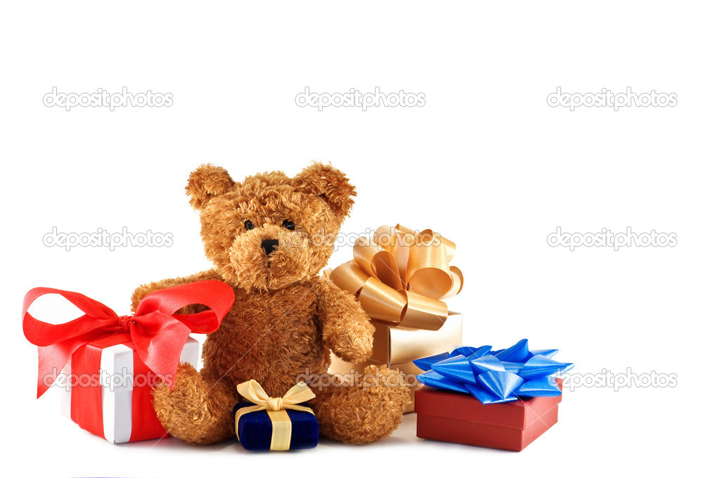 Teddy bear with presents isolated  Stock Photo #6716450