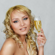 Young blonde woman with champagne glass — Stock Photo
