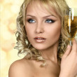 Stock Photo: Young blonde woman with champagne glass