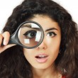 Woman with magnifying glass — Stock Photo