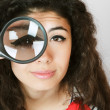 Woman with magnifying glass — Stock Photo #5796488