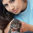 Woman holding a kitten — Stock Photo