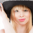 Beautiful young woman in hat — Stock Photo