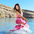 Woman dancing in water — Stock Photo