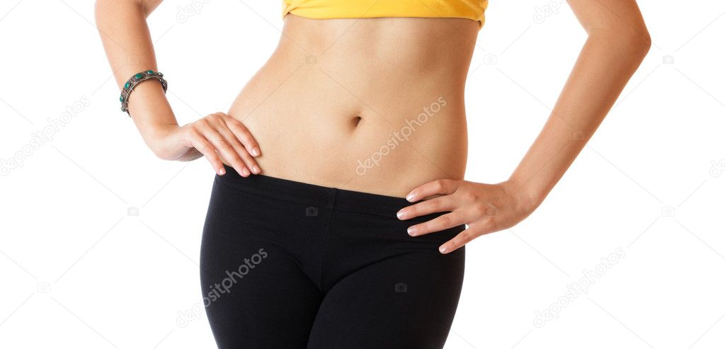 Slender young woman with flat abs and slim waist isolated over white background  Stock Photo #6350443