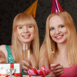 Royalty-Free Stock Photo: Two young woman celebrating birthday