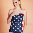 Foto Stock: Blond woman in american flag