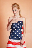 Blond woman in american flag — Stok fotoğraf