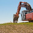 Hydraulic Excavator at Work - Stock Photo