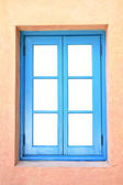 Blue wooden frame window — Stockfoto