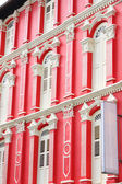 Red building and white windows — Stock Photo