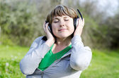 Woman and headphone — Stock Photo
