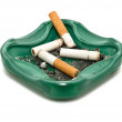 Ashtray and cigarette butts, isolated on white background — Stock Photo
