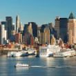 NEW YORK CITY SKYLINE WITH BOATS - Stock Photo