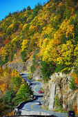 Autumn mountain with winding road — Stock Photo