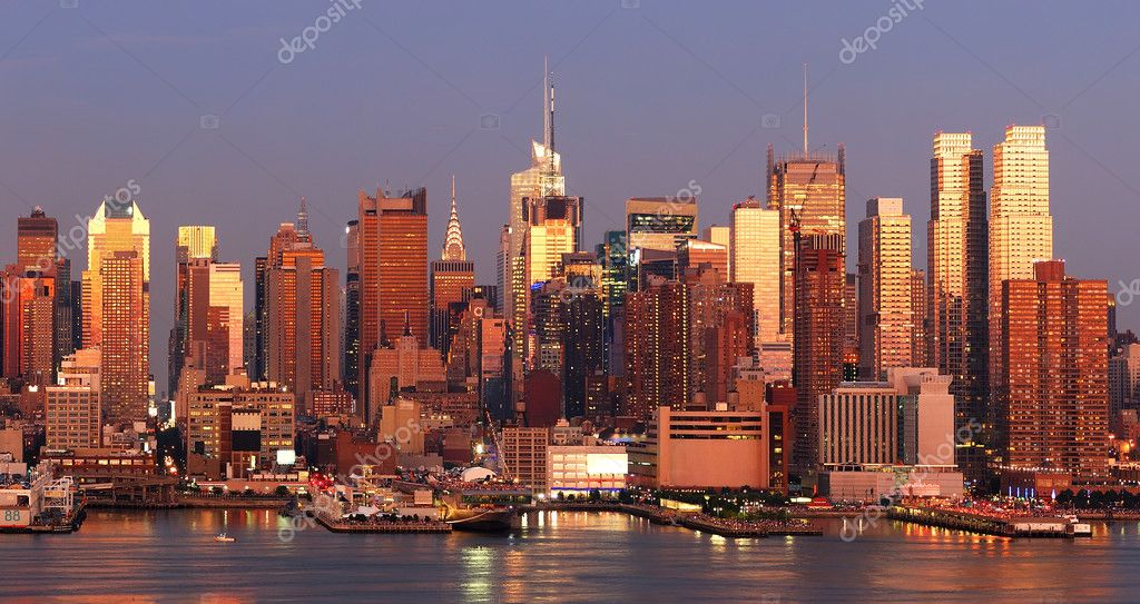 New York City Manhattan skyline panorama at sunset with Times Square and skyscrapers with reflection over Hudson river. — Stock Photo #5567768