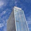 Sloping skyscraper with glass facade — Stockfoto #6690884
