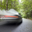 Stock Photo: Car speeding