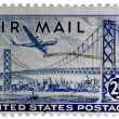 Stock Photo: Old air mail stamp isolated on plain background