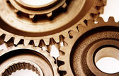 Closeup of three gears meshing together — Stock Photo