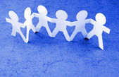 Group of paperchain holding hands — Stock Photo
