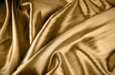Closeup of rippled tan color silk — Stock Photo