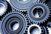 Closeup of several steel cog wheels — Stock Photo