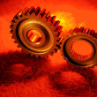 Closeup of two steel gears joining - Stock Photo