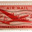 Stock Photo: Old air mail stamp isolated on white