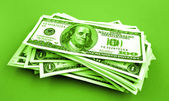 Pile of American cash on green — Stock Photo