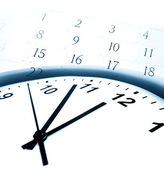Closeup of clock face and calendar numbers — Stock Photo