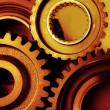 Stock Photo: Closeup of steel gears joining together