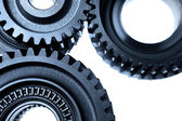 Closeup of steel gears joining together — Stock Photo