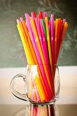 Plastic straws in plexy glassware — Stock Photo