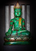 Green wood carving Buddha image — Stock Photo